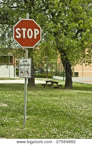 Stop traffic sign in a green meadow
