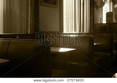 Restaurant Booths With Streaming Sunlight In Sepia