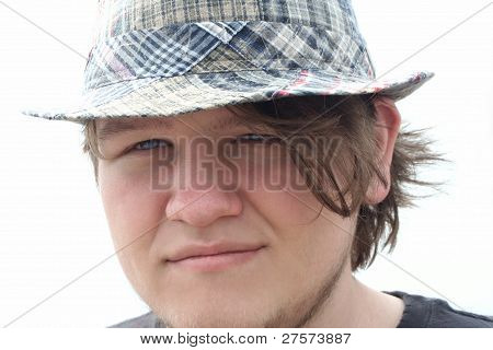 Serene Teen Boy In Plaid Hat