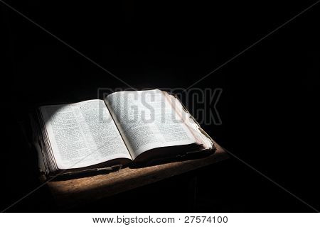 Open Bible Lying On A Table