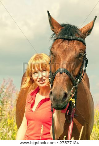 young pretty girl  with her horse