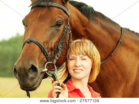 portrait of young pretty girl  with her horse