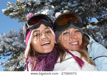 Two women ready to ski