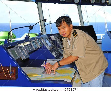 Navigation Officer Works With A Navigation Chart