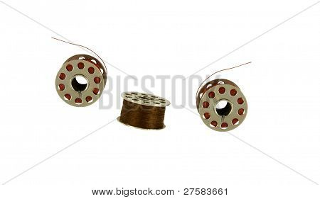 three used bobbin
