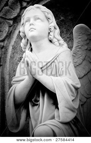 Beautiful black and white image of a marble angel in an old gothic church