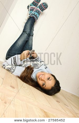 Young woman lying on the floor of the house