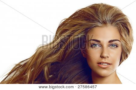 beautiful blond woman with long curly hair on whie background