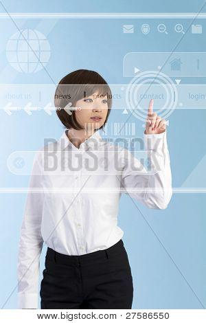 Beautiful business woman pushing touch screen interface