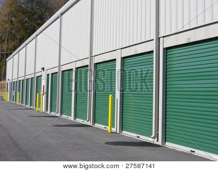 Row of outdoor green door self-storage units