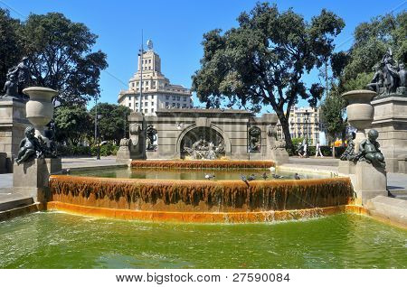 BARCELONA, SPAIN - AUGUST 16: Fountain in Plaza Catalunya on August 16, 2011 in Barcelona, Spain. The most important streets of the city meet at Plaza Catalunya, considered the centre of the city