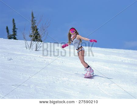 Young Woman In Lingerie On A Snowboard