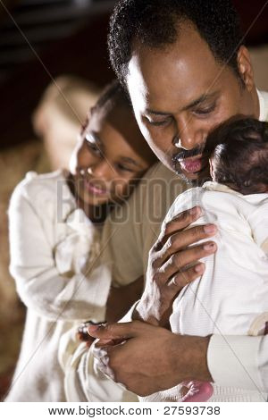African American father with his beautiful children