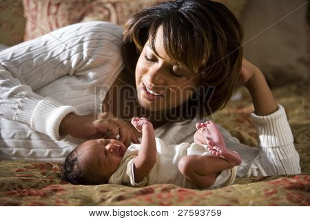 African American mother admiring her newborn child