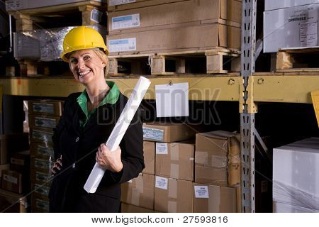 Female office worker standing in storage warehouse