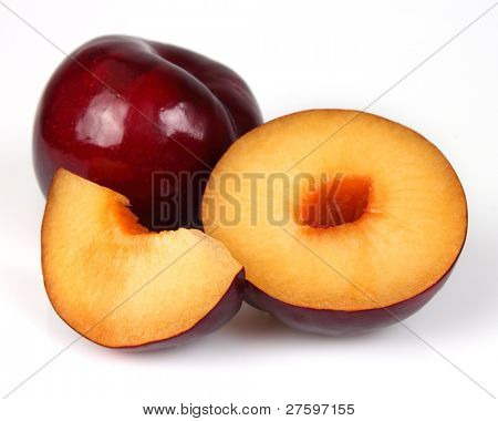 Fresh plum with slices. Use it for a health and nutrition concept.