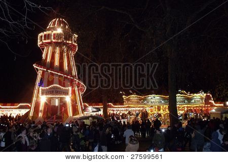 LONDON- DEC 17: Crowds of 1000s enjoy the rides and attractions of the famous Winter wonderland, held yearly at Hyde park, London, dec 17, 2011.