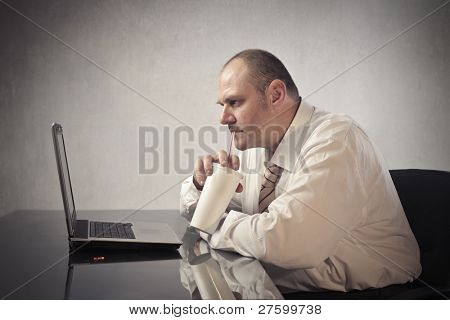 Fat businessman drinking a sparkling beverage