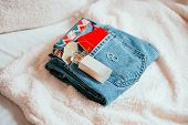 Cozy Fashion Flatlay With Blue Jeans, Red Notebook, Perfume Bottle And Accessories. Minimalistic Fla poster