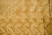 foto of asura  - Bas relief carving showing Asura demons pulling on the god snake Vasuki in the Hindu legend the Churning of the Ocean of Milk - JPG