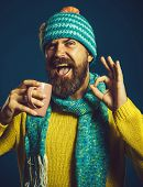 Happy Man In Sweater And Scarf Holds Cup Of Hot Tea Showing Ok Gesture. Cool Manly Stylish Fashionab poster