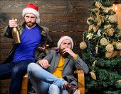 Men Drink Champagne And Smoking. Brutal Men Celebrate New Year Near Christmas Tree. New Years Resolu poster