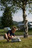 image of recreational vehicle  - Little boy playing at camping site - JPG