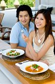 stock photo of thai food  - A young attractive couple eating Thai food - JPG
