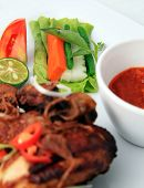 pic of ayam  - Javanese fried chicken named ayam kalasan focus on raw vegetables - JPG