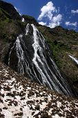 foto of firn  - Waterfalls and snowfields in summer - JPG
