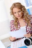 pic of storyboard  - Beautiful photographer looking at story board for photo session - JPG