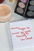 Coco Chanel Quotes Written On A Block Note, Pearl Accessories And Make Up On White Background, Inspi poster