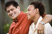 image of teenage boys  - Hispanic father with African American teenage son - JPG