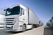 stock photo of fleet  - Modern European Truck with semitrailers convoy on road - JPG