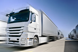 image of b-double  - Modern European Truck with semitrailers convoy on road - JPG