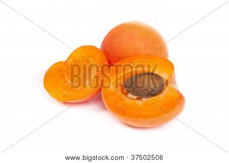 Apricots. Group Of Ripe Apricots With A Half Sectioned By Knife
