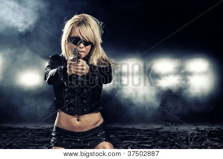 special  tactics sexy woman holding up her weapon