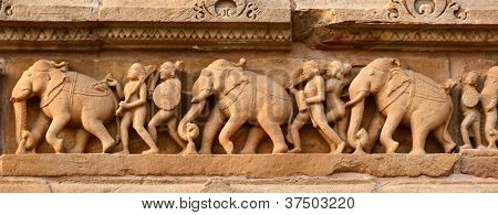 Stone carving bas relief panorama, Lakshmana Temple, Khajuraho, India. Unesco World Heritage Site