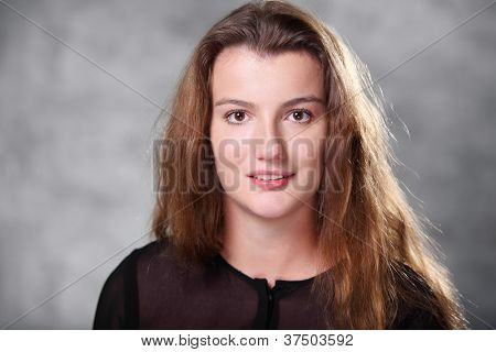 Portrait of beautiful long, brown hair young girl  in photo studio, close