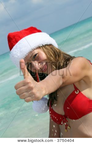 Happy Woman On The Beach In Santa Hat