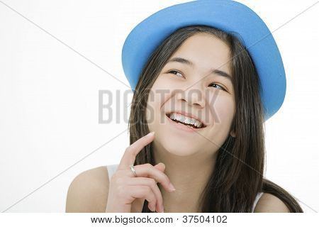 Young Teenage Girl In Blue Hat, Laughing With Thoughtful Expression.isolated On White.