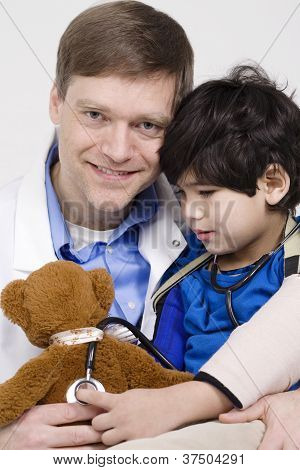 Doctor playing with little patient during check up