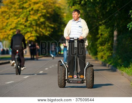 MOSCOW - SEPTEMBER 12: Man rides Segway near Gorky Park on September 12, 2012 in Moscow. City government has built a new bicycle path on the embankment of the Moscow River for citizens recreation.