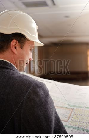 Engineer Looking At Plans.
