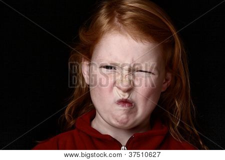 Angry Young Girl Grimacing
