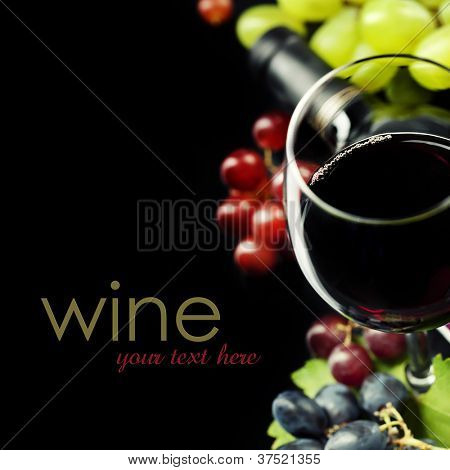 Glasses of  wine and grape on black background  (easy removable sample text)