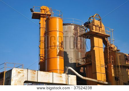 Cement factory machinery and a blue sky