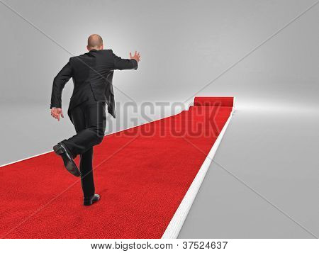 businessman run on 3d red carpet