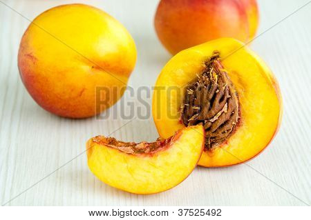 Fresh Peaches On White Table