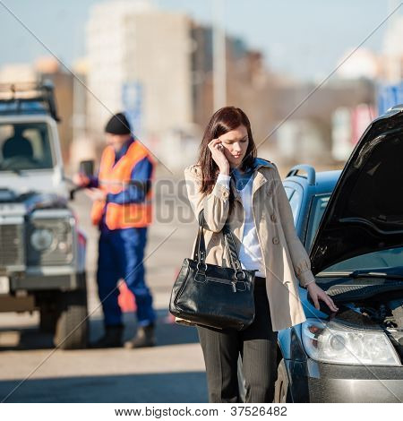 Woman on the phone after car crash breakdown talking upset